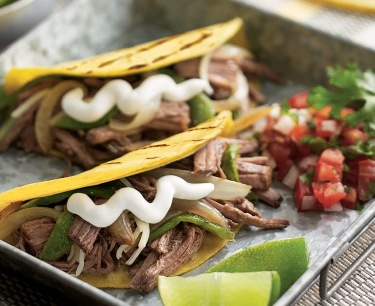 Beef brisket tacos with sour cream