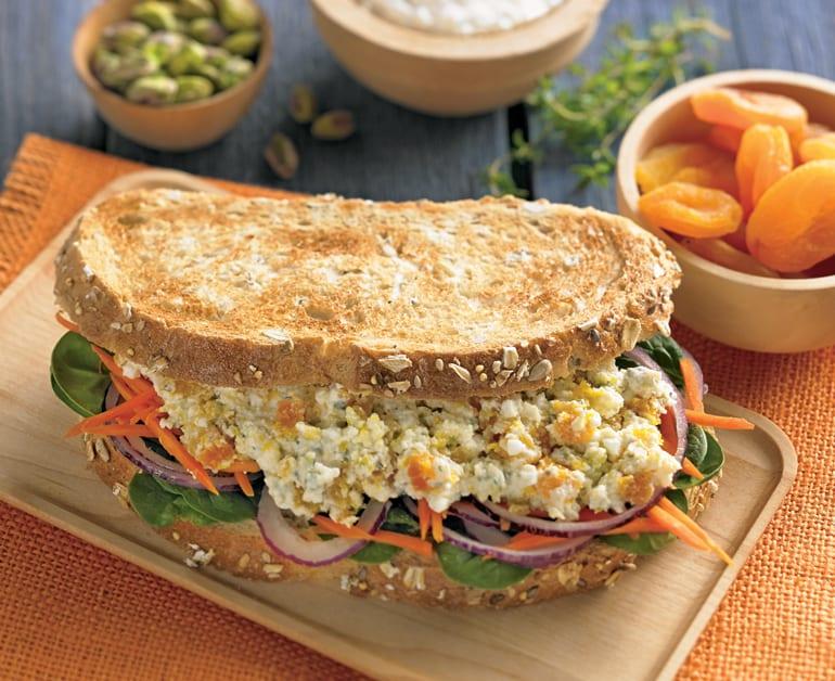 Cheesy Apricot Pistachio and Greens Sandwich slider image 1