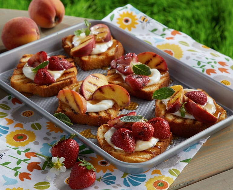 Grilled Pound Cake with Peaches and Strawberries slider image 1