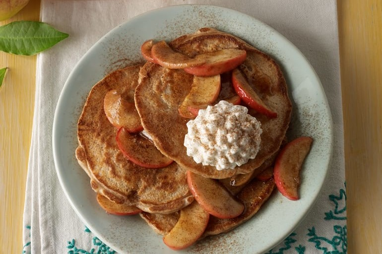 stack of cinnamon apple pancakes with cottage cheese and apples on top