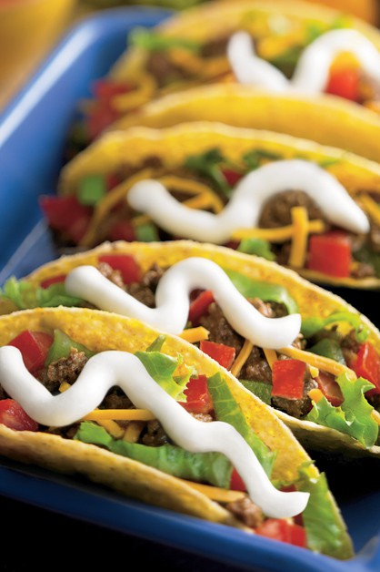 Beef tacos with sour cream
