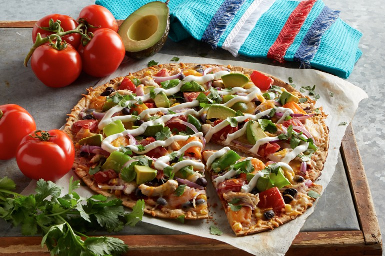 southwest pizza with sour cream on top