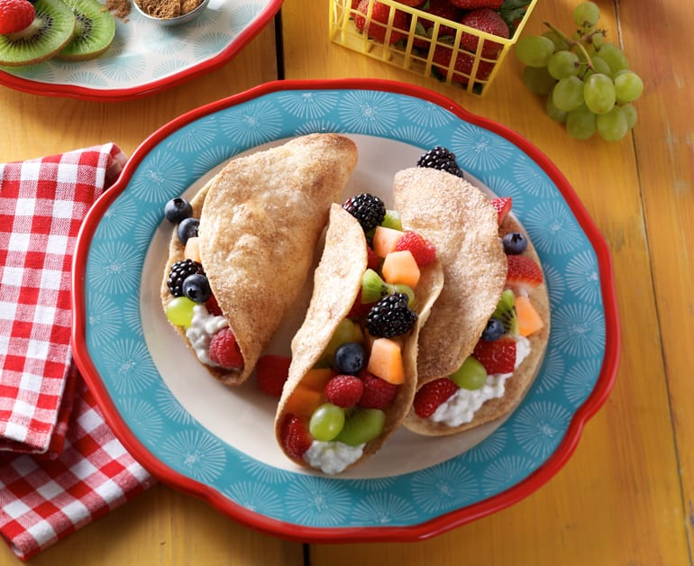 Fruit tacos with cottage cheese on plate