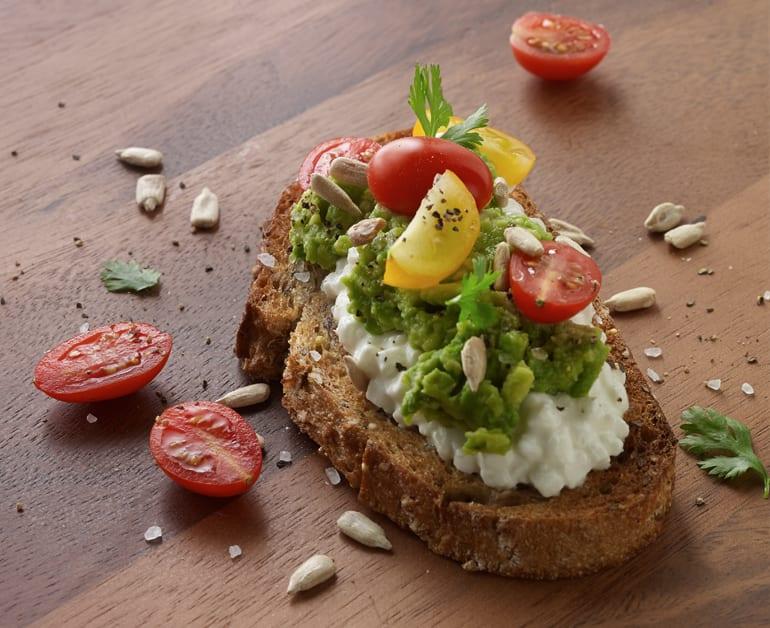 Rustic Cheese, Avocado, Tomato Crostini slider image 1