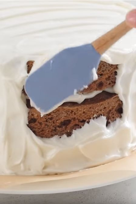 Carrot Cake being iced